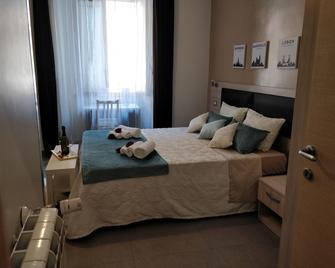 Guest House Aria Bixio - Roma - Habitación