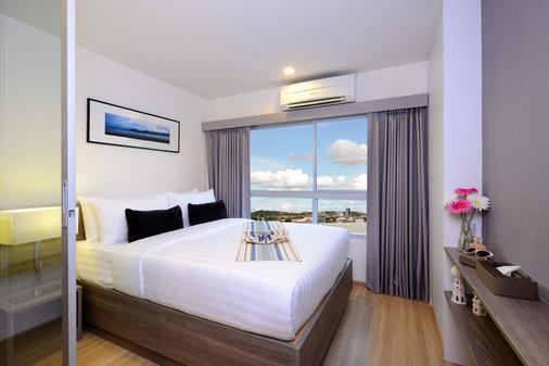 The Grass Serviced Suites - Pattaya - Schlafzimmer