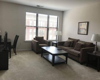 Bridgestreet At The Avant Apartments - Reston - Living room