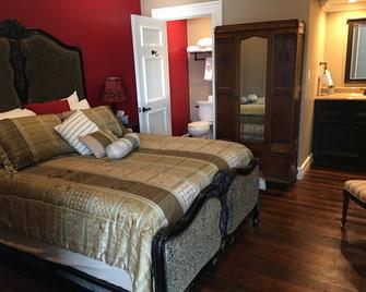 Kahn Hotel - Jefferson - Спальня