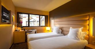 أوتل دي برين - تولوز - غرفة نوم