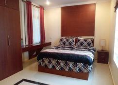 Ausindo Apartments - Batuampar - Habitación