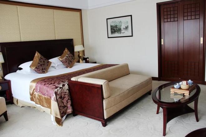 Deefly Zhejiang Hotel - Hangzhou - Bedroom