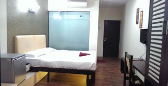 Hotel Enzo International - Bengaluru - Bedroom