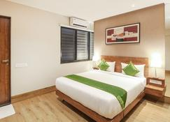 Treebo Trend Elite Residency - Belgaum - Bedroom