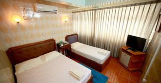 Beautyland Hotel Ii - יאנגון - חדר שינה