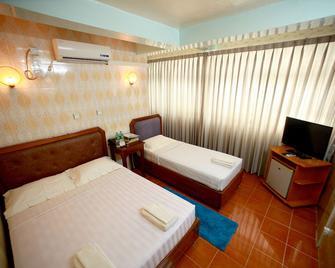 Beautyland Hotel II - Yangon - Bedroom