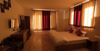 Radhu's Boutique Inn - Leh - Schlafzimmer