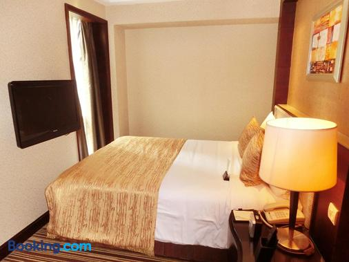 Leeden Hotel Guangzhou - Guangzhou - Bedroom