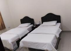Arjaan Salalah Furnished Apartment - Salalah - Habitación