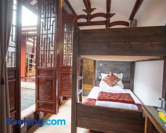 Chaozhou Manju Inn - Шаньтоу - Bedroom