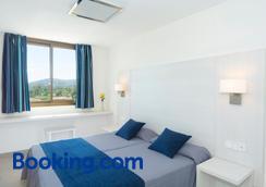 Apartamentos HSM Lago Park - Can Picafort - Bedroom