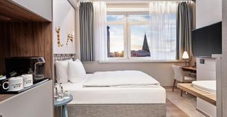 H+ Hotel Bremen - Bremen - Schlafzimmer