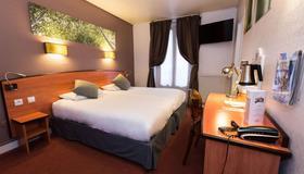 Kyriad Paris 13 - Italie Gobelins - Paris - Schlafzimmer