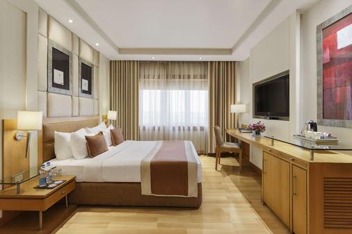 尊爵公園廣場酒店 - 勒希安納 - 盧迪亞納 - 臥室