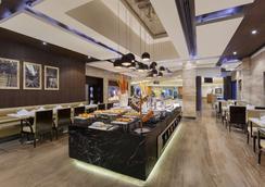 尊爵公園廣場酒店 - 勒希安納 - 盧迪亞納 - 餐廳