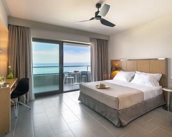 Ostria Sea Side Hotel - Chaniotis - Bedroom
