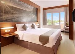 Hotel Neo Palma Palangkaraya By Aston - Palangkaraya - Bedroom