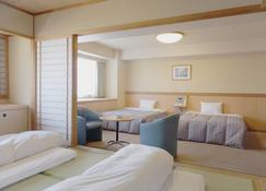 Itoen Hotel Atamikan - Atami - Slaapkamer
