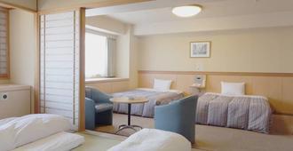 Itoen Hotel Atamikan - Atami - Makuuhuone