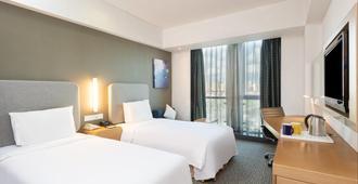 Holiday Inn Express Shanghai Jinsha - שנחאי - חדר שינה