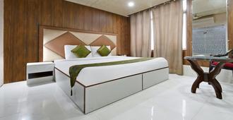 Treebo Trend Glory Villa - Niu Đê-li - Phòng ngủ