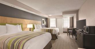 Country Inn & Suites by Radisson, Pigeon Forge S - פיג'ון פורג' - חדר שינה