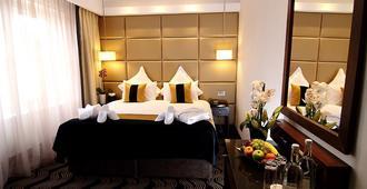 The Piccadilly London West End - לונדון - חדר שינה