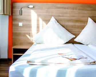 Orange Hotel und Apartments - Neu Ulm - Bedroom