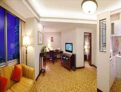 Ramada Plaza by Wyndham Tian Lu Hotel Wuhan - Wuhan - Sala de estar