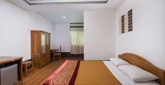 M.G.M Hotel - Rangun - Schlafzimmer