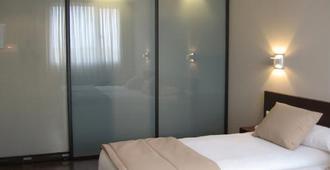 Hotel Abad San Antonio - León - Bedroom