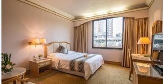 Panyu Hotel - גואנגג'ואו - חדר שינה