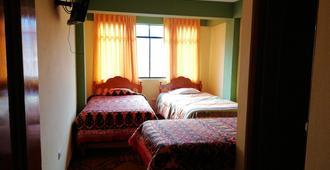 Artesonraju Hostel Huaraz - Huaraz - Bedroom