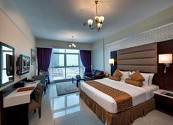 Emirates Grand Hotel Apartments - Dubái - Habitación