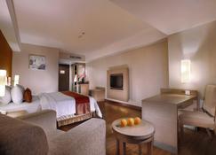 Grand Aston City Hall Hotel & Serviced Residences - Medan - Habitación
