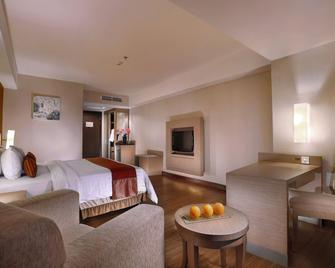 Grand Aston City Hall Hotel & Serviced Residences - Medan - Bedroom
