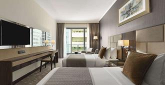 Hawthorn Suites by Wyndham Abu Dhabi City Centre - Abu Dhabi - Bedroom