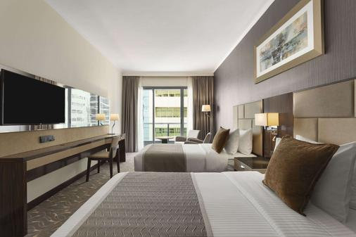 Hawthorn Suites by Wyndham Abu Dhabi City Center - Abu Dhabi - Schlafzimmer