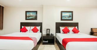 OYO 399 Paragon Tower Hotel - מנילה - חדר שינה