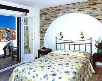 Naxos Palace Hotel - Stelida - Спальня