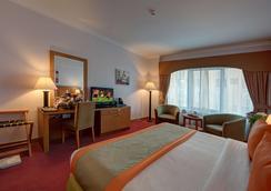Golden Tulip Nihal Palace Hotel - Dubai - Bedroom