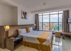 Golden Tulip Dar Es Salaam City Center Hotel - Dar Es Salaam - Bedroom