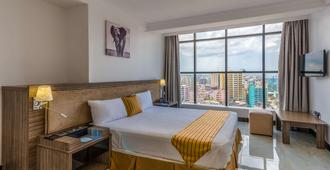 Golden Tulip Dar Es Salaam City Center Hotel - Дар-эс-Салам - Спальня