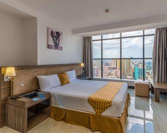 Golden Tulip Dar Es Salaam City Center Hotel - Daressalam - Schlafzimmer