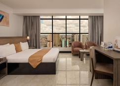 Golden Tulip Dar Es Salaam City Center Hotel - Dar es Salaam - Habitación