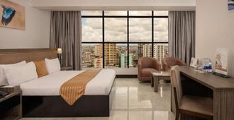 Golden Tulip Dar Es Salaam City Center Hotel - דר א-סאלאם - חדר שינה