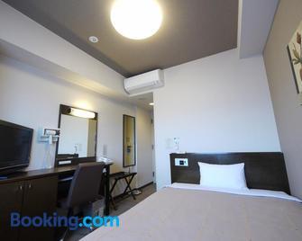 Hotel Route-Inn Aomori Chuo Inter - Aomori - Bedroom