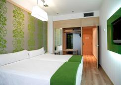 NH La Avanzada - Bilbao - Schlafzimmer