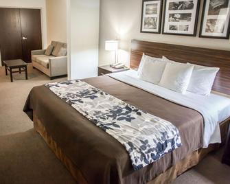 Sleep Inn & Suites Indoor Waterpark - Liberty - Ložnice